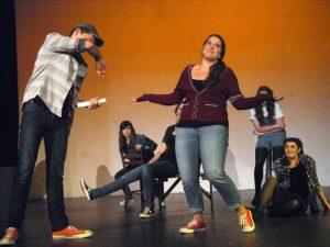 Senior Showcase: Standing Center in maroon sweater